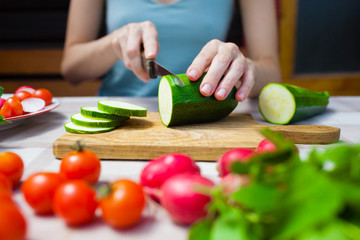 Woman cutting vegetables.