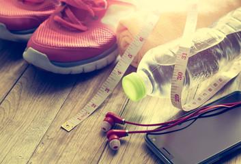 Sneakers, towel, water, tape measure, earphones and smart phone