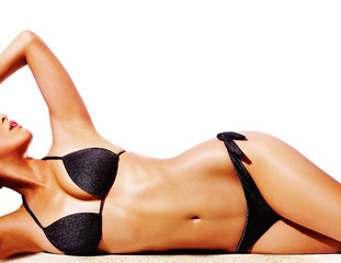 Beautiful woman body with black bikini isolated on white background. Perfect body skin.