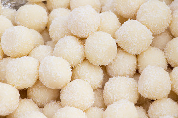 Sweet coconut balls as a background. Vedic cooking.