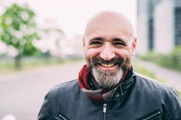 Portrait of happy mature male motorcyclist