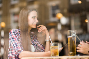 Window view of young couple in bar
