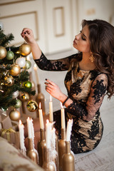 Christmas Mood. Beautiful woman model. Makeup. Healthy long hair
