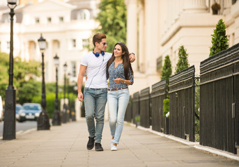 Young couple strolling on city street, London, UK