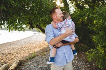 Father and young son hugging at Lake Ontario, Oshawa, Canada