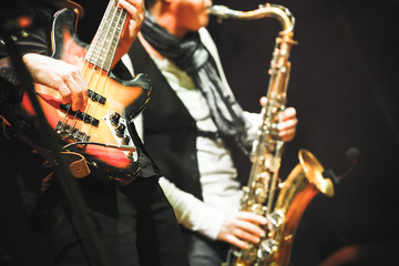 Guitar player and saxophonist on a stage
