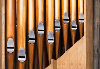 Closeup photo of shining organ tubes