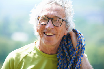 Portrait of rock climber looking at camera smiling