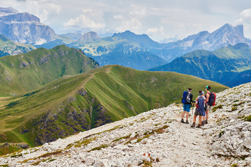 Scenic view of hikers on rocky mountainside, Austria