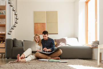 Couple with laptop looking at paperwork