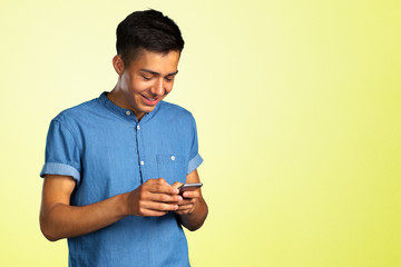 young man looking on his smartphone