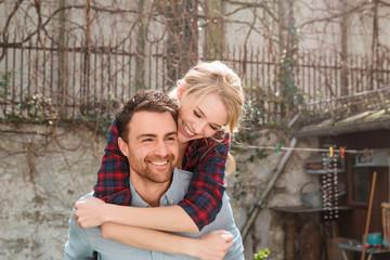 Man giving woman piggyback smiling