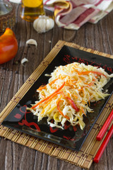 Korean salad of cabbage, carrots, sweet peppers - kimchi in an A