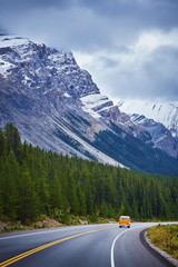 Vintage recreational vehicle driving on highway, Banff National Park, Alberta, Canada