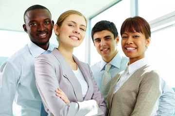 Group of young business people smiling and looking at camera