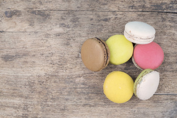Sweet and colourful french macaroons on retro vintage wooden bac