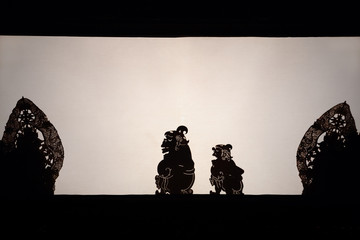 Black shadow silhouette of old traditional puppets of Bali Island - Wayang Kulit. Culture, religion, Arts festivals of Balinese and Indonesian people. Travel background