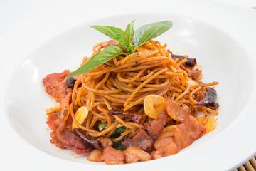 spicy thai spaghetti on white dish