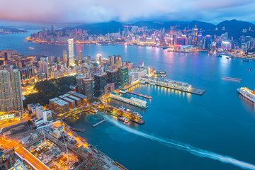 Night at the Victoria Harbor in Hong Kong city skyline