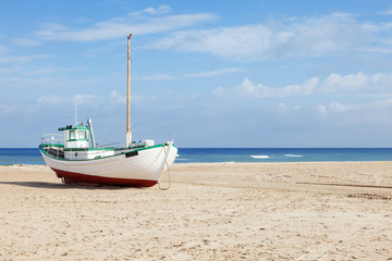 Fishing boats stranded on the beach