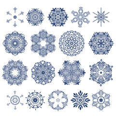 Vector set of beautiful ornamental snowflakes isolated on white. For Christmas and New Year design.