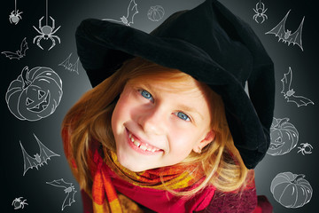 Halloween funny little girl looking at camera black background