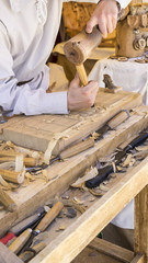 Furniture, craftsman carving wood in a medieval fair, carpentry