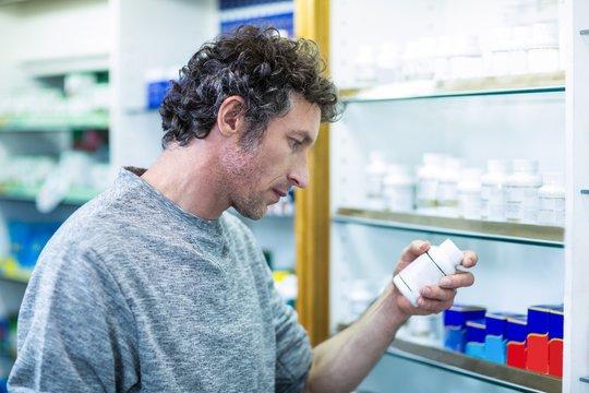 Customer holding a pill box