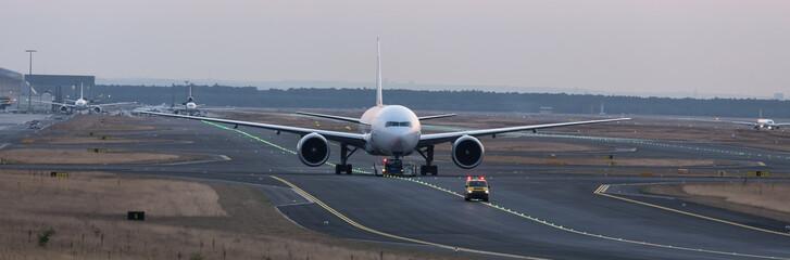 Tuinposter Vliegtuig airplane beeing towed on a runway