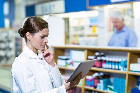 Pharmacist using digital tablet