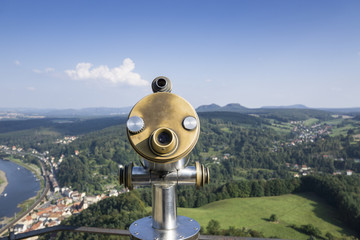 Public binocular telescope (binoscope) on the top of observation deck - view to the mountains landscape