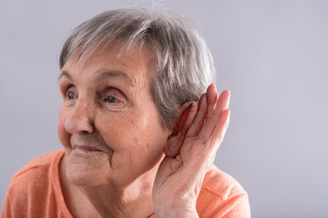 Old woman with earing problem