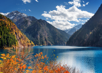 Amazing view of the Long Lake among mountains and fall woods