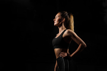 Studio shot of a beautiful young woman posing against a black background. This is what hard work and dedication looks like