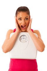 Woman with scale as a healthy lifestyle reminder isolated over w