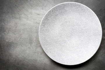 Empty Plate over Slate Top View