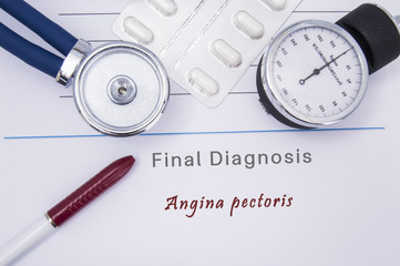 Paper medical form with a text diagnosis of Angina pectoris on which lie the stethoscope, blood pressure monitor, white tablets or pills in a blister pack and a red ballpoint pen