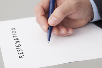 Man Writing a Letter of Resignation