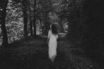 Fototapeta Running woman in the forest obraz