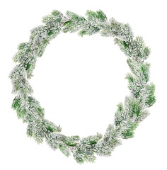 green Christmas wreath in snow isolated on white