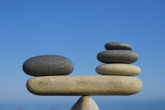 Balance of stones: a combination of pros and cons.