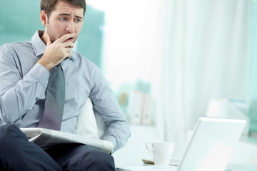 Businessman sitting at his office and getting bad news
