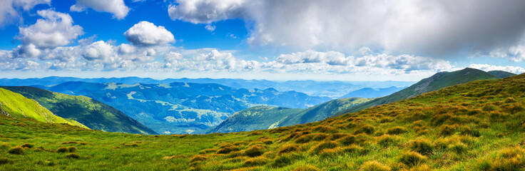 Picturesque Carpathian mountains landscape in summer, wide angle panoramic view, Ukraine.