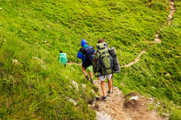 Group of tourists hiking in Carpathian mountains, nature landscape, Chornogora ridge, Ukraine.