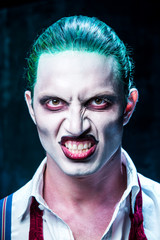 Bloody Halloween theme: crazy joker face