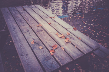 Fallen autumn leaves on a wooden table