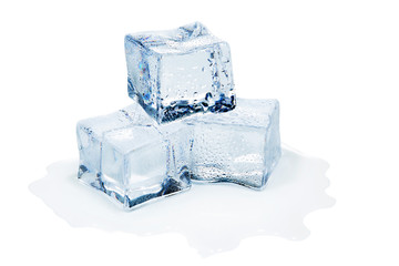 three ice cubes melting on white background
