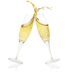 two champagne glasses toasting on white background