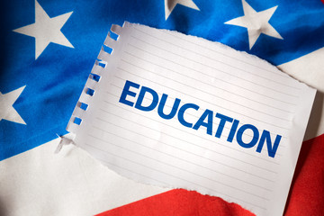 Education on notepaper and the US flag