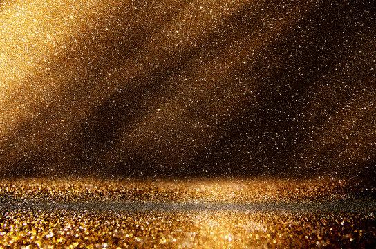 glitter vintage lights background. dark gold and black. defocuse